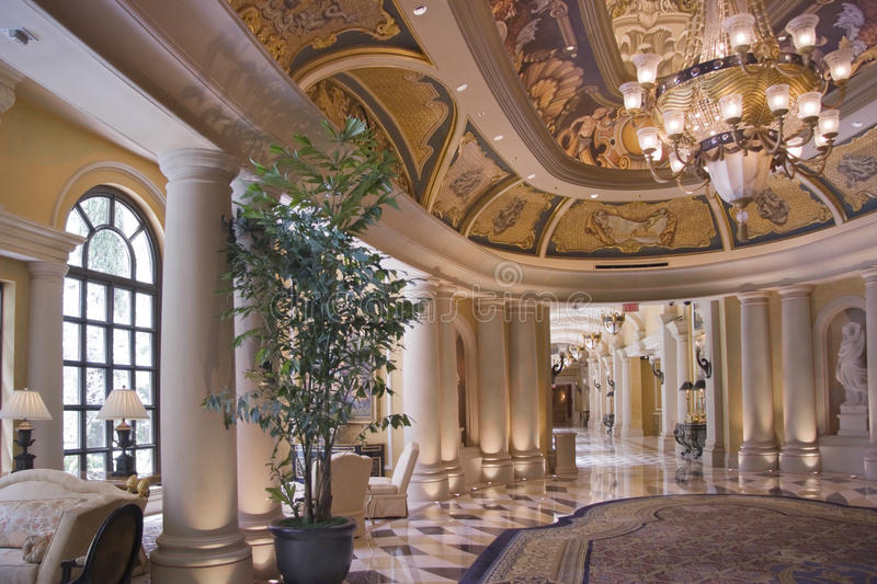 Luxury classic corridor and ornate luster stock photography