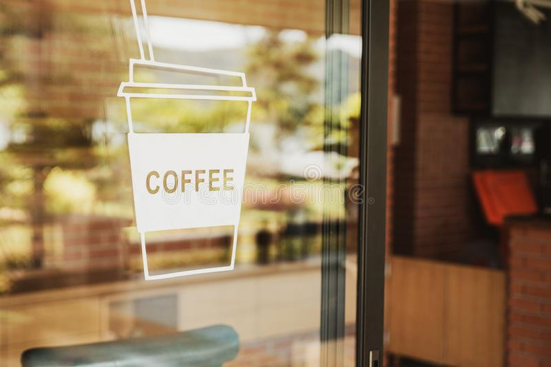 Luxury coffee shop sign on the glass door. For art texture or we. B design backgrund royalty free stock photos
