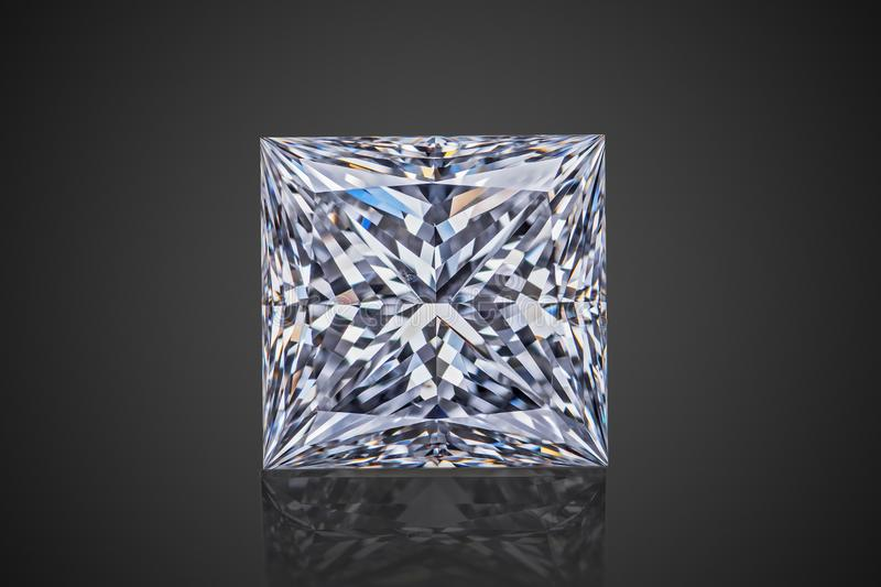 Luxury colorless transparent sparkling gemstone square shape princess cut diamond on black background stock images