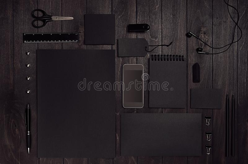 Luxury corporate identity template with black blank paper stationery set, phone on dark elegant wood board. Mock up for branding, business presentations and royalty free stock photo