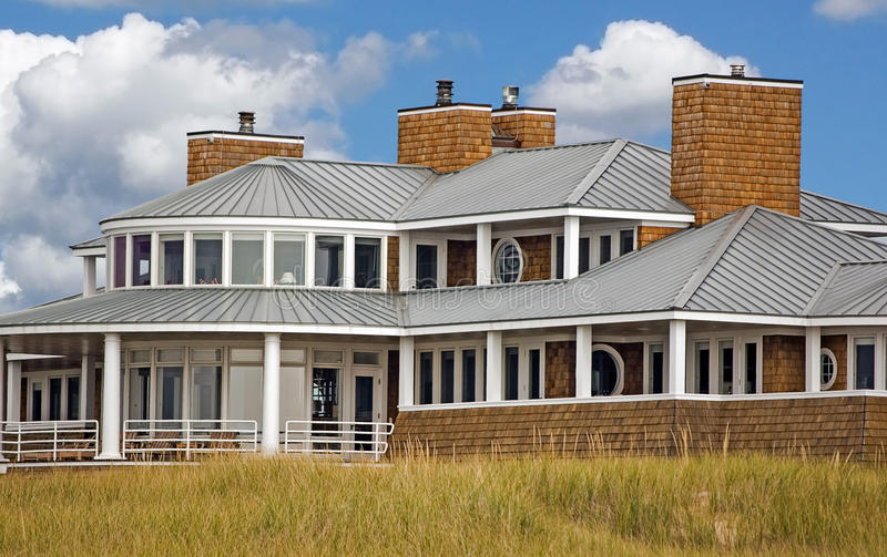 Luxury cottage in beach grass stock image