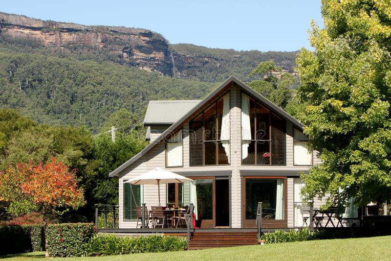 Luxury country retreat with with upper kangaroo valley mountains and waterfall in the background stock photography