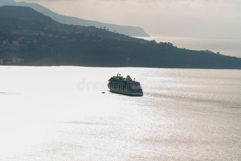 Luxury Cruise Ship Sailing far to the horizon in the bay, Sorrento Italy royalty free stock image