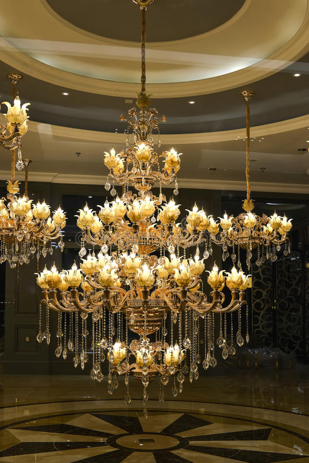 Luxury crystal ceiling lighting in a shopping mall stock image luxury crystal chandelier lighting in a glass shop windowchinaasia the crystal ceiling lamp is lit up by led lamp bulbsit is usually decorated in the aloadofball Images