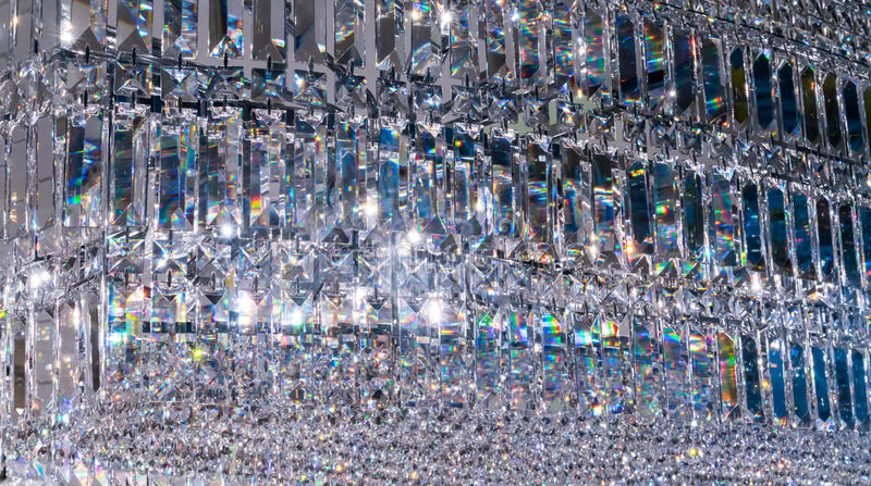 Luxury Crystal Chandelier. Close up on the crystal of a contemporary decoration. stock photo