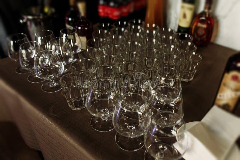 Luxury crystal whiskey whisky glasses on dark wooden background stock photography