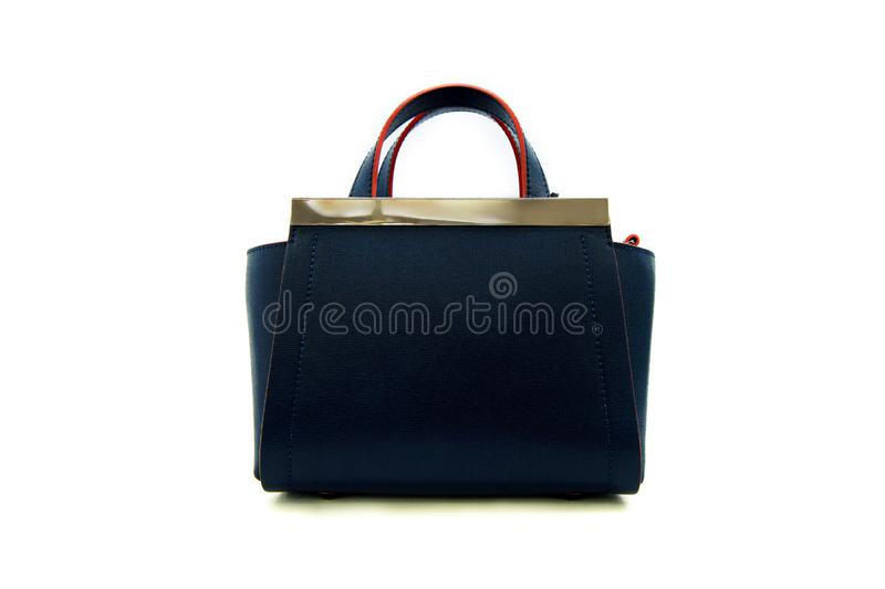 Luxury dark blue leather holding female fashion hand bag. Isolated white sale object women expensive lady modern casual black design classic vanity vogue fancy stock photo