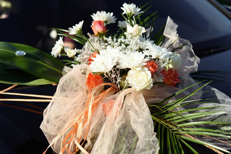 Luxury decorated rich car with bouquet of flowers, wedding trans royalty free stock photo