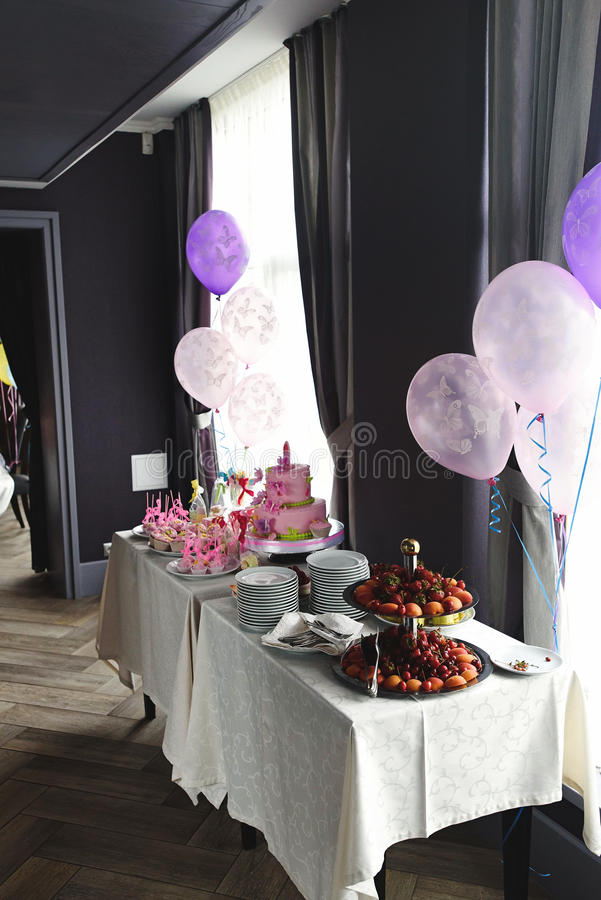 Luxury delicious pink candy bar table at birthday celebration, c stock photo