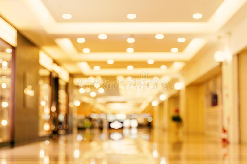 Luxury department store shopping mall interior, abstract defocused blur with bokeh background, concept of shopping seasons design.  stock image
