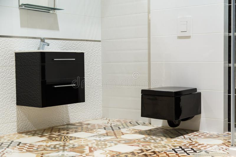 Luxury design of bathroom with black toilet bowl and washbasin.  royalty free stock photo