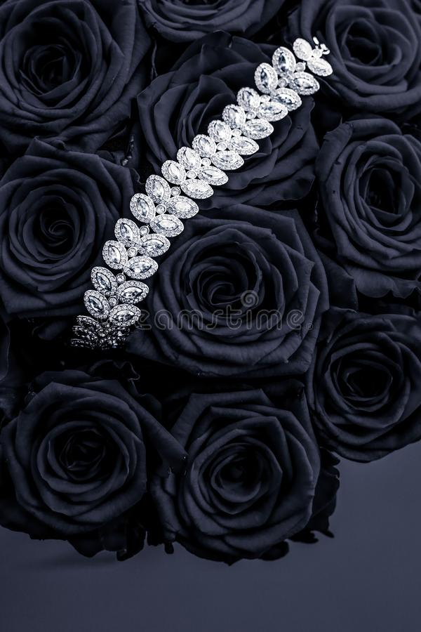 Luxury diamond jewelry bracelet and black roses flowers, love gift on Valentines Day and jewellery brand holiday background design. Luxe branding, glamour stock images