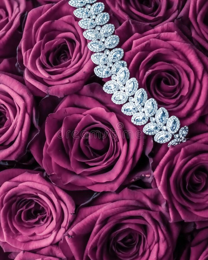 Luxury diamond jewelry bracelet and pink roses flowers, love gift on Valentines Day and jewellery brand holiday background design. Luxe branding, glamour fashion royalty free stock image