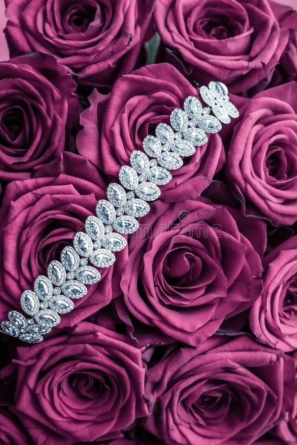 Luxury diamond jewelry bracelet and pink roses flowers, love gift on Valentines Day and jewellery brand holiday background design. Luxe branding, glamour fashion royalty free stock photography