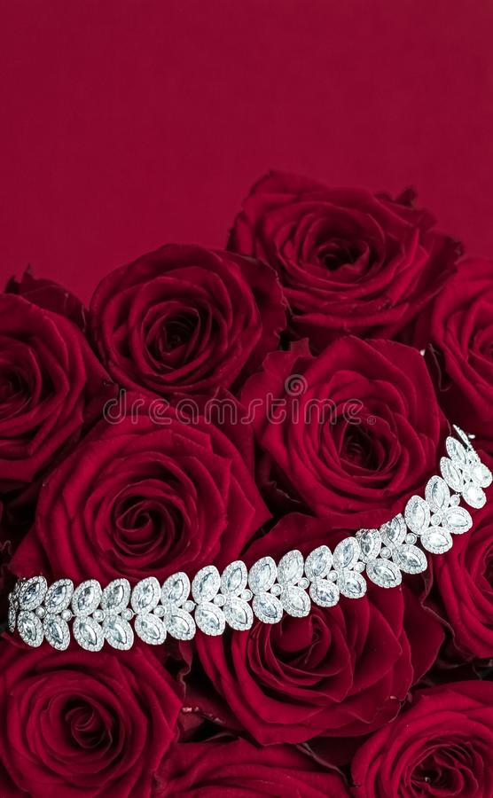 Luxury diamond jewelry bracelet and red roses flowers, love gift on Valentines Day and jewellery brand holiday background design. Luxe branding, glamour fashion royalty free stock images