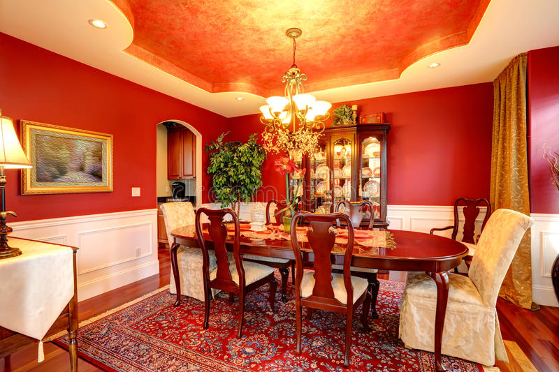 Download Luxury Dining Room In Bright Red Color Stock Photo