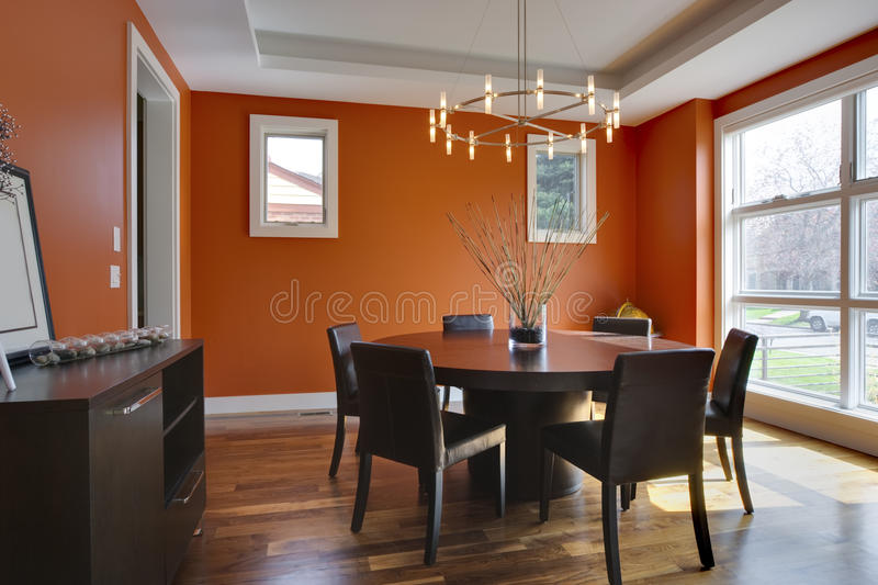 Luxury Dining Room with Orange Walls royalty free stock photo