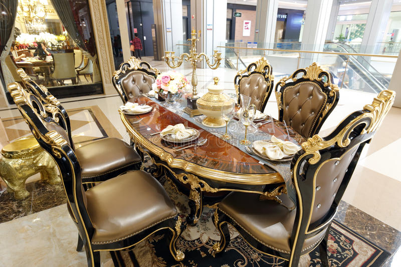Luxury dining table in home decoration shop royalty free stock photography