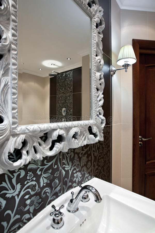 Luxury domestic room interior. Interior of luxury domestic room with expensive framed mirror stock photos