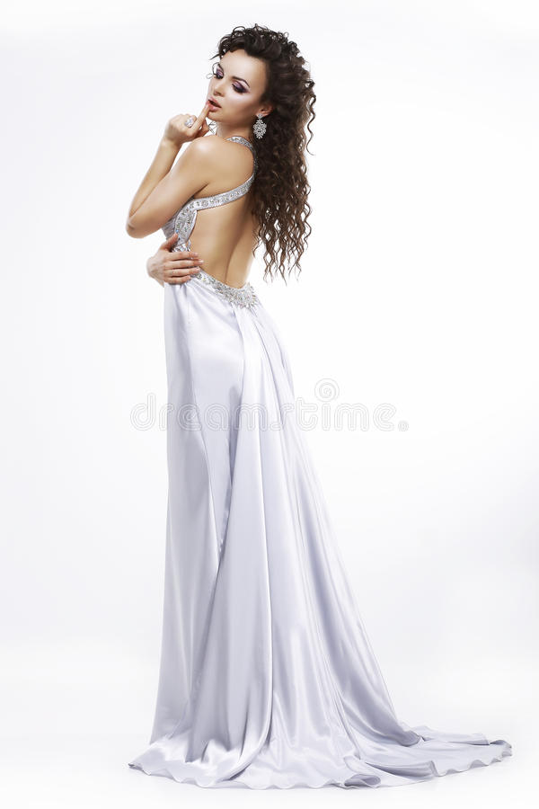 Luxury. Elegance. Glamorous Woman in Light Shiny Dress. Dolce Vita stock image