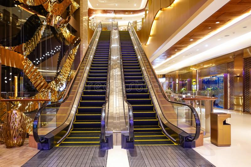 Luxury  elevator in modern commercial building  hotel hall. Luxury golden  elevator  lit by led lighting  in modern commercial building stock photos