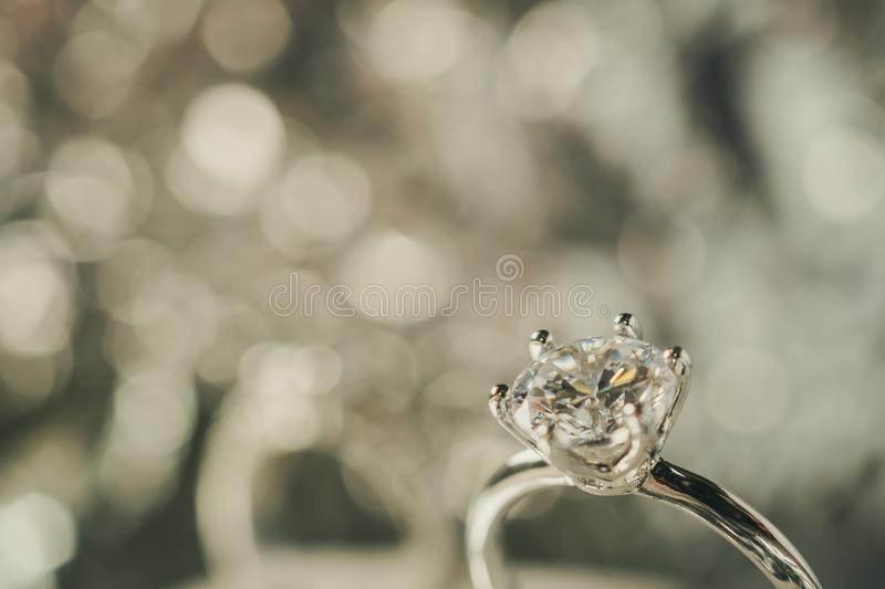 Luxury engagement Diamond ring with abstract bokeh light. Background stock image