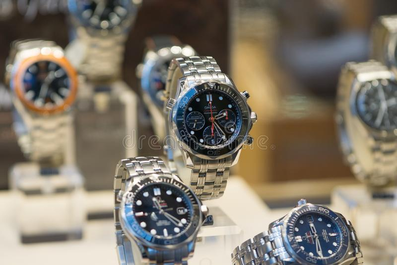Luxury Omega Seamaster watches on display in store window, shallow depth of field. Luxury, expensive Omega Seamaster watches on display in a store window, in royalty free stock images
