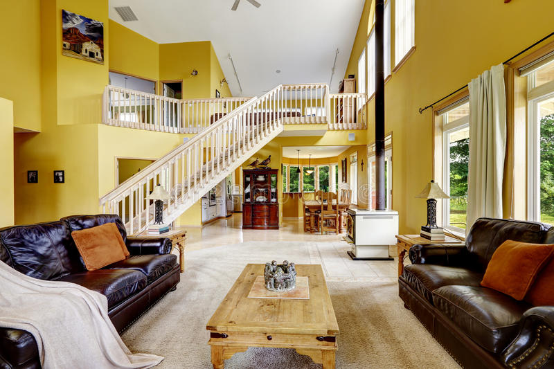 Download Luxury Family Room With Rich Furniture And Staircase To Loft Stock  Image   Image Of