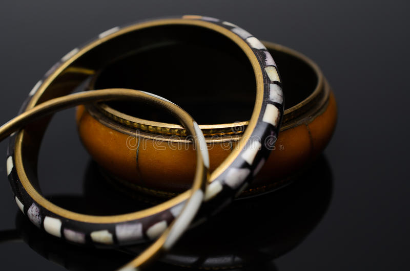 Luxury fashion pearl earrings on black background. Gold fashion bracelets on a black background stock photo