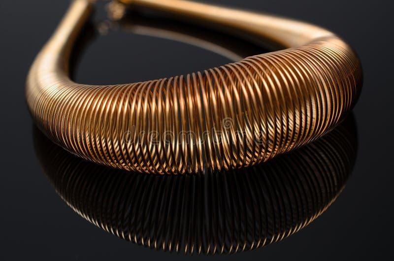 Luxury fashion pearl earrings on black background. Gold fashion necklace on a black background stock image
