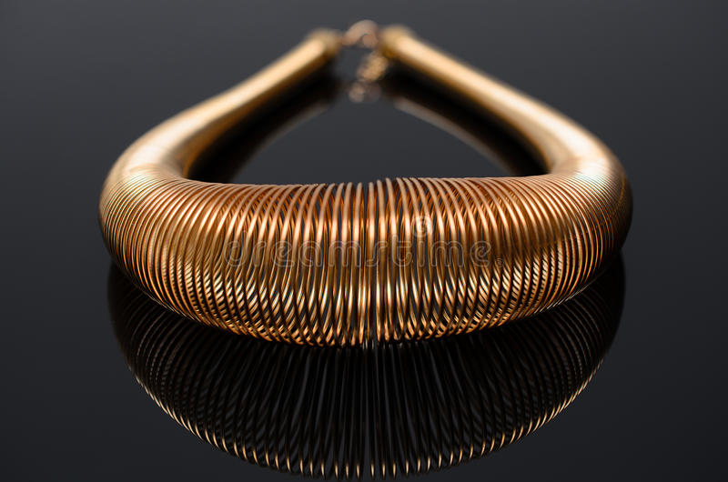 Luxury fashion pearl earrings on black background. Gold fashion necklace on a black background stock photography