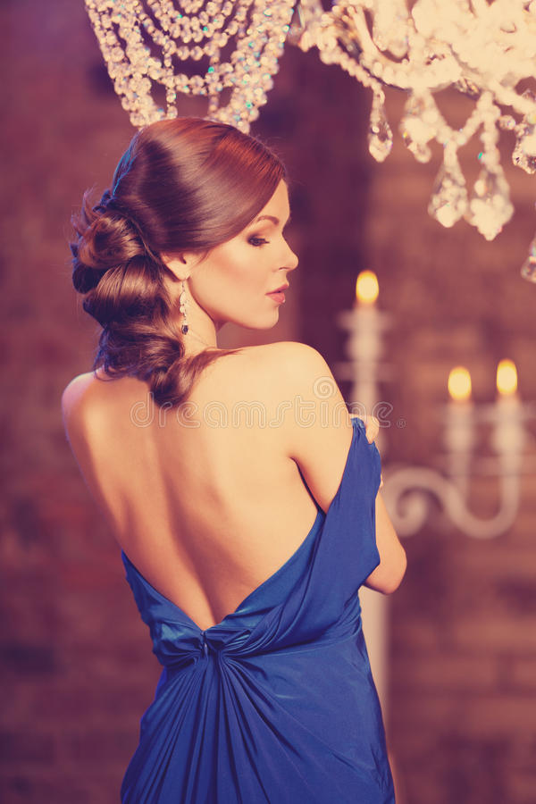 Luxury fashion stylish woman in the rich interior. Beautiful girl with a fashionable hairstyle and makeup chic royalty free stock photos