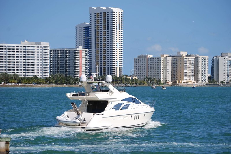 Luxury Fishing Boat. 55' luxury fishing boat cruising on the intercoastal near Miami Beach with high rise condominiums in the south beach section of Miami Beach stock photo