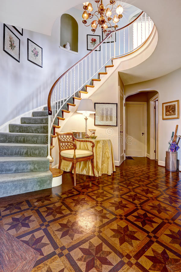 Foyer Stairs Review : Luxury foyer with designed hardwood floor and spiral