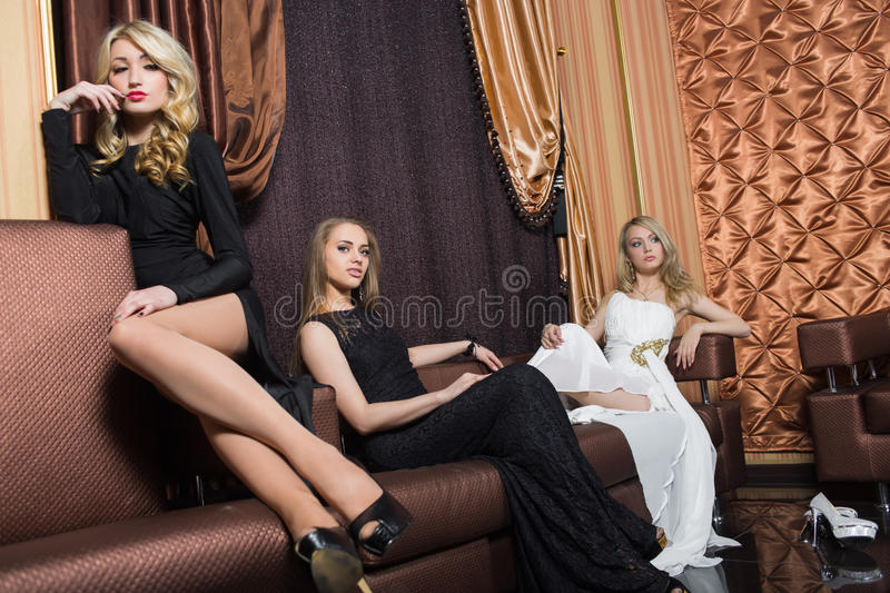 Luxury girls in evening dresses. beautiful. Chic luxury girls in evening dresses in beautiful settings royalty free stock photography