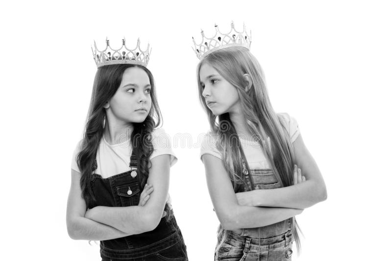 Luxury and glamoury. Adorable little girls with luxury and chic look. Small cute children wearing luxury crowns stock images