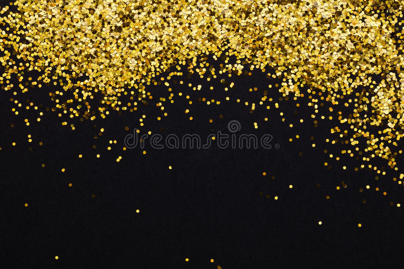Luxury gold glitter sparkles frame on blac stock photo