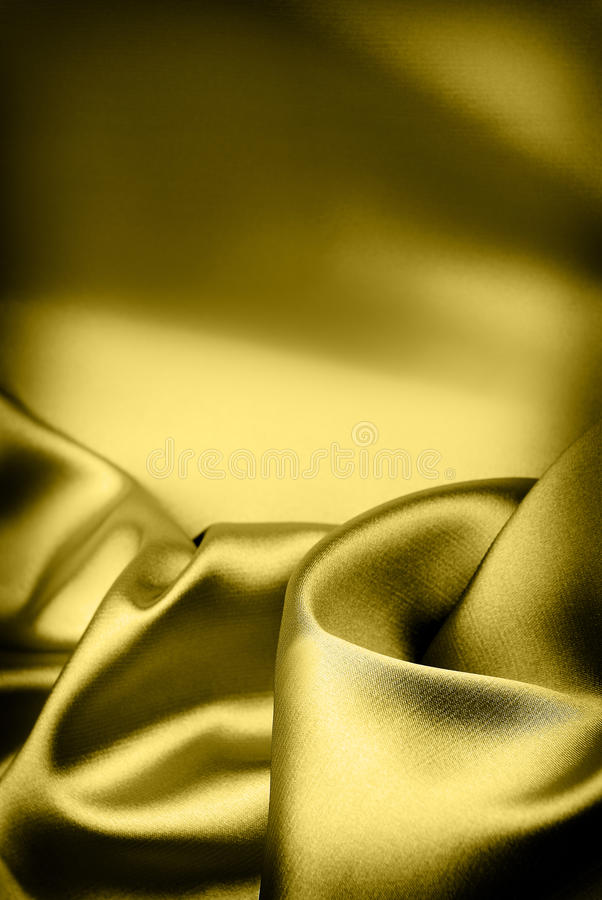 Luxury gold silk background. With place for text royalty free stock photography