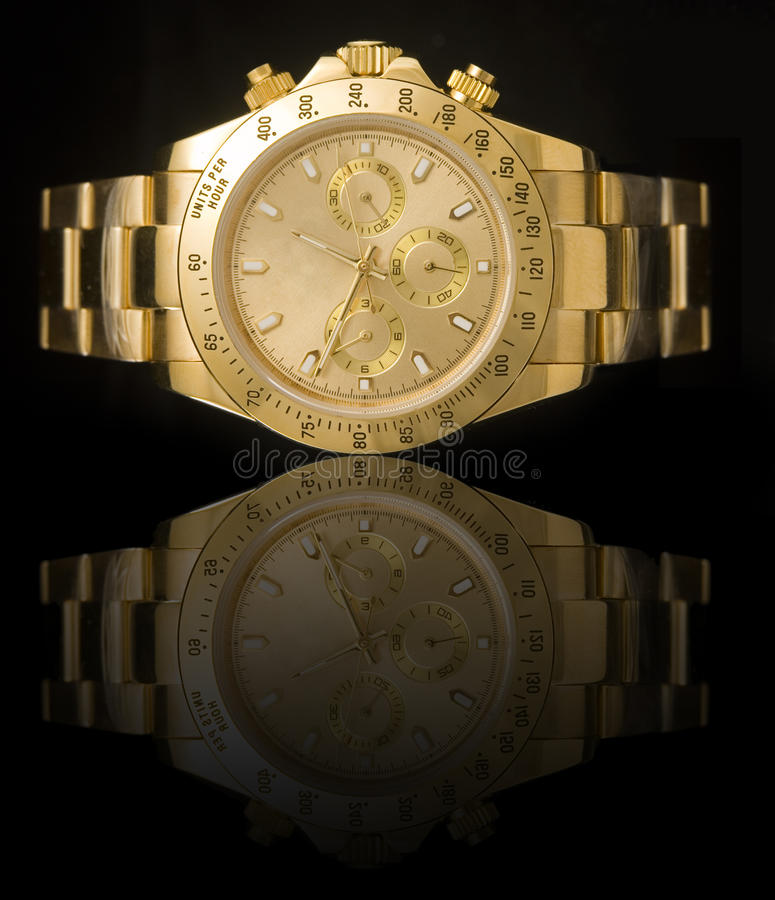 Luxury gold watch. Isolated on black background with reflection stock photos