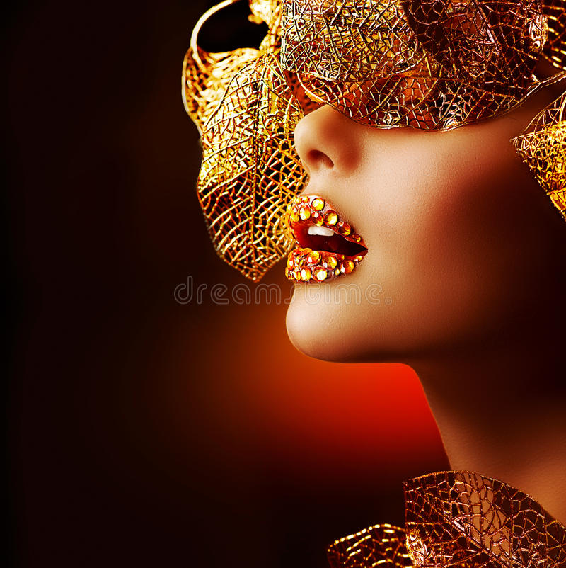 Luxury Golden Makeup. Beautiful Professional Holiday Make-up royalty free stock image