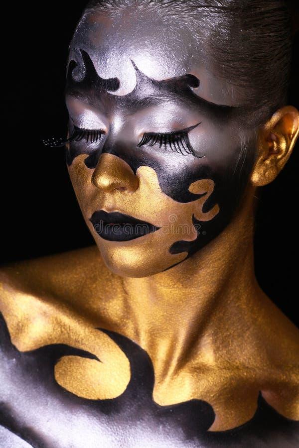 Luxury Golden Makeup. Beautiful Professional Holiday Make-up royalty free stock photo