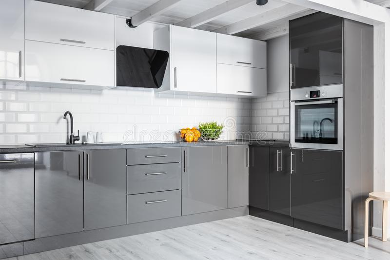 Gray kitchen with brick wall royalty free stock photography