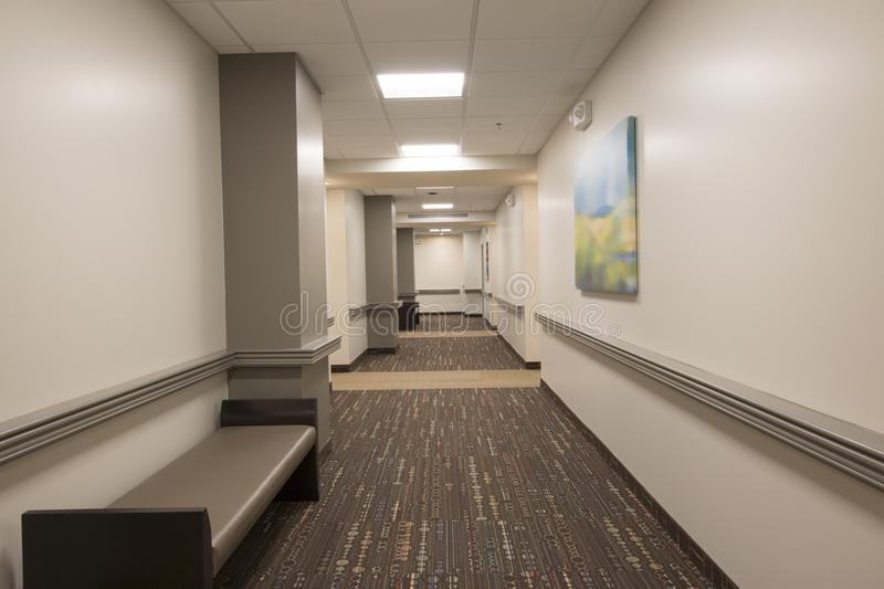 Assisted Living Apartment Hallway. Luxury hall area of new assisted living apartment building for senior citizens stock photo