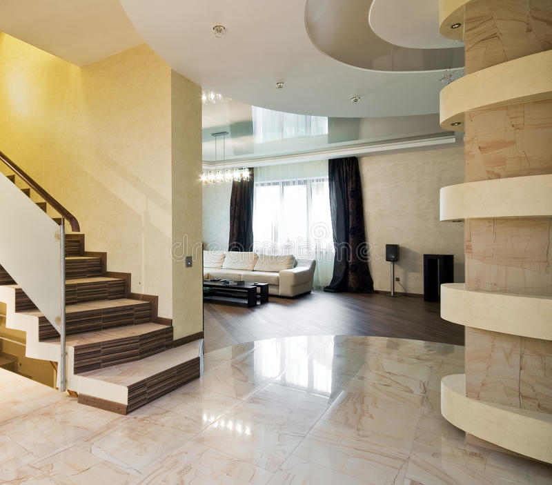 Luxury hall with staircase. In a new house royalty free stock photography