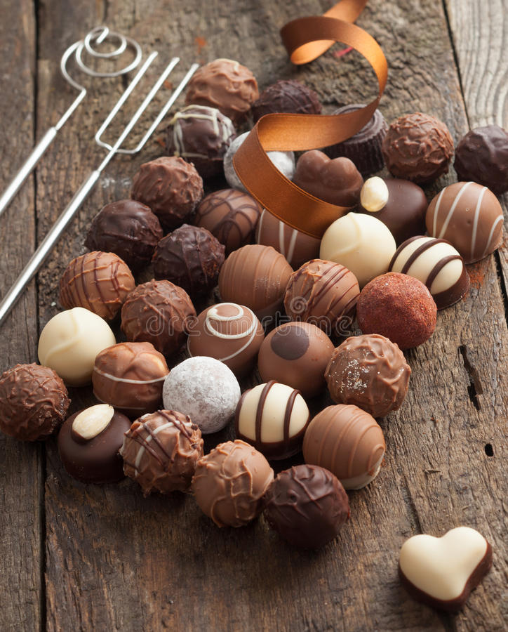 Luxury handmade chocolate bonbon assortment. Of delicious decorative round chocolates with a festive ribbon for a celebration stock photography