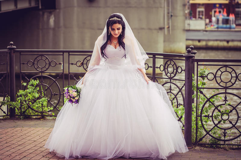 Luxury and happy bride in a city stock images