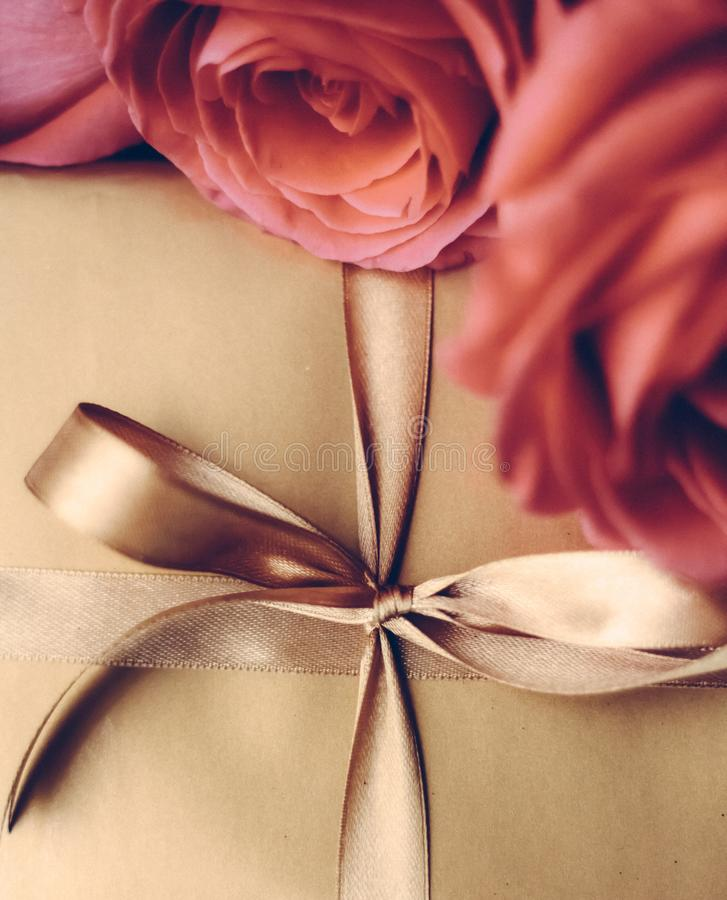 Luxury holiday golden gift box and bouquet of roses as Christmas, Valentines Day or birthday present. Vintage design, shop sale promotion and happy surprise stock photos