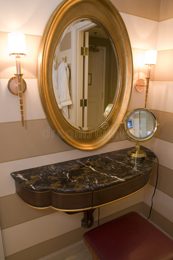Luxury home bathroom. Luxurious bathroom with stylish mirrors and lamps royalty free stock photo
