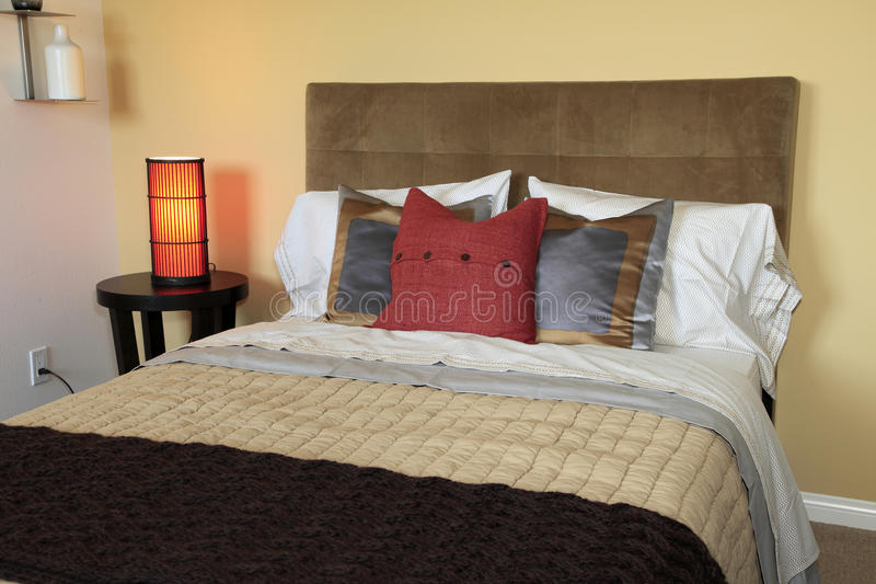 Luxury home bedroom. Luxury home bedroom with stylish furniture and decor royalty free stock photo