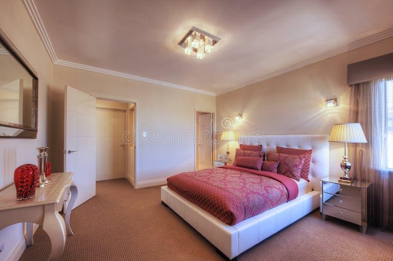 Luxury Home Bedroom. Luxury Home Interior Queensize Bedroom royalty free stock image
